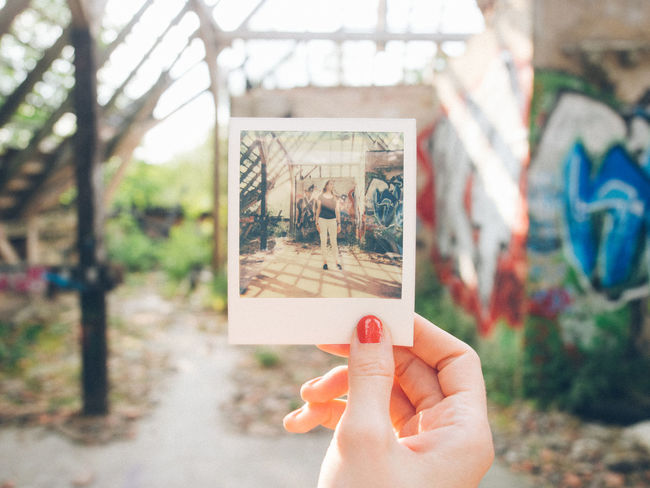 Instant Film Fun in an abandonded place in Berlin Day Different Perspective Focus On Foreground Holding Human Finger Impossibleproject Leisure Activity Lifestyles Person Personal Perspective Polaroid The Week On EyeEm Unrecognizable Person