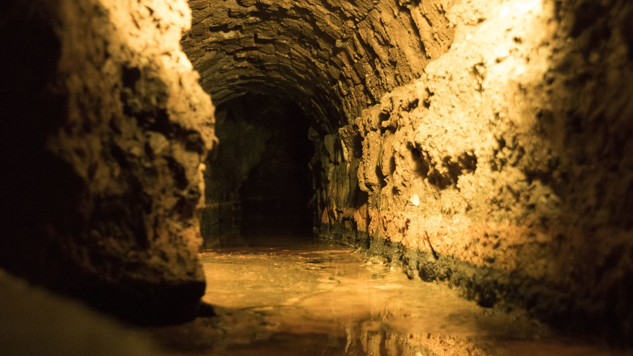 indoors, tunnel, rock - object, cave, arch, underground, no people, architecture, textured, cellar, basement, day
