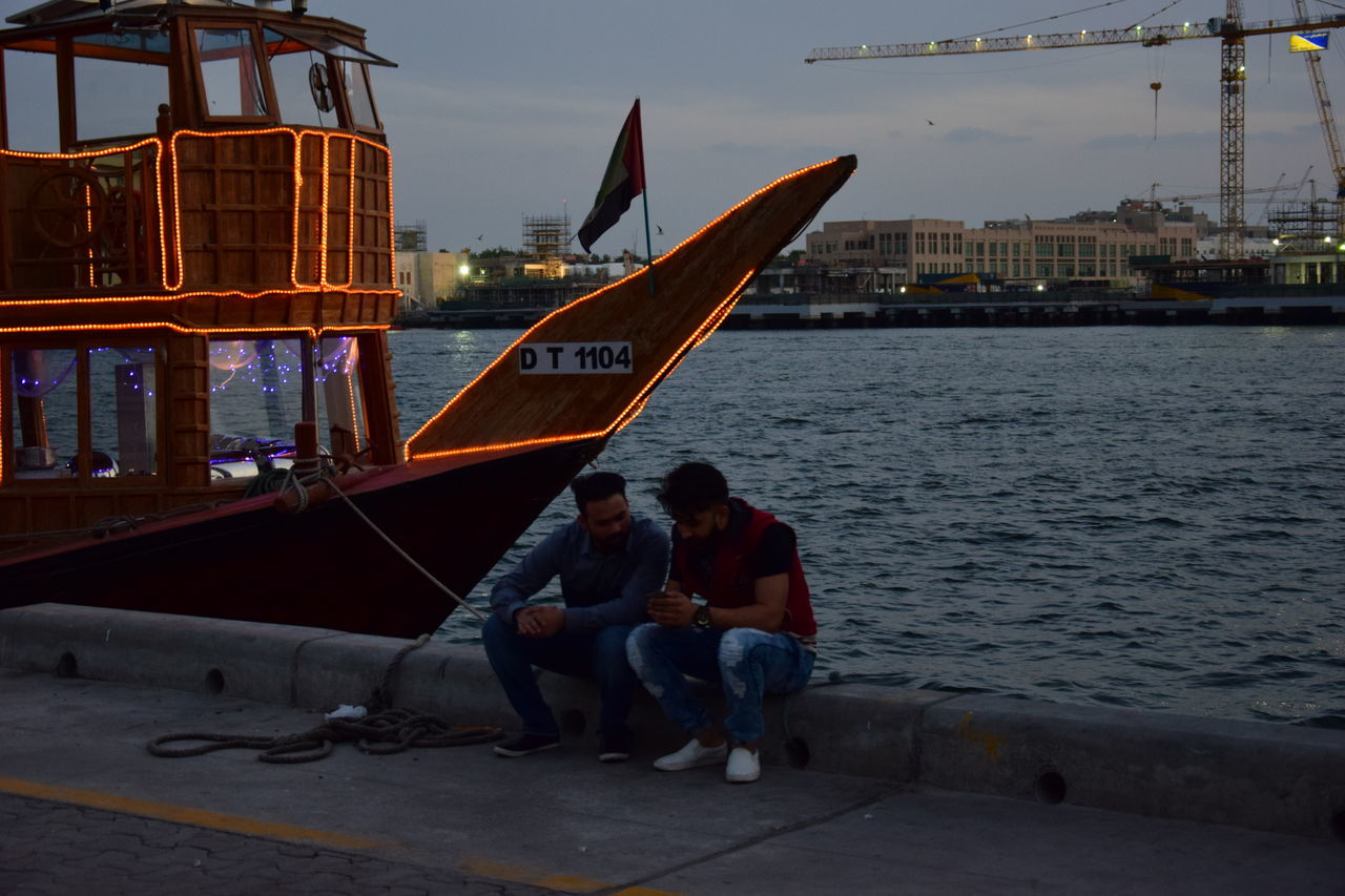 One evening in Deira Creek, Dubai Deiracreek Deiradubai Dubai Dubai❤ Evening In Deira Dubai Friendship Harbor Leisure Activity Nautical Vessel Neighborhood Map Outdoors Real People Real People, Real Lives Sitting Two People