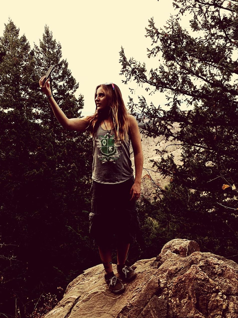 A friend of mine taking a selfie on the mountain. Beauty One Person One Young Woman Only Adult Tree Nature Young Women Beautiful Woman Smiling Young Adult Outdoors Beauty In Nature Mountain Rocks Denver,CO Lookout Mountain Autumn Sky Real People Day Standing Selfie ✌ Inthemoment