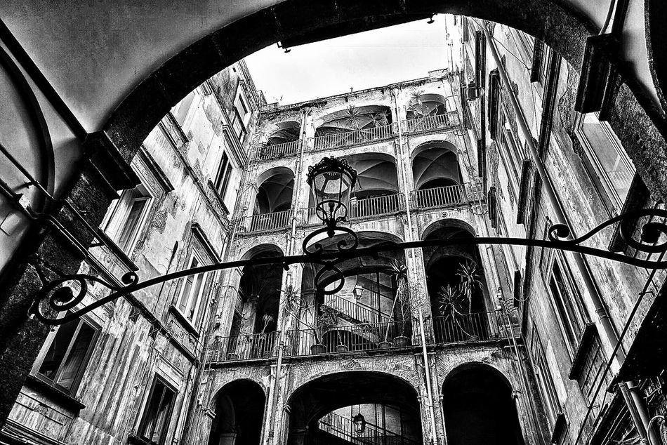 Naples historic buildings. Streetphotography Low Angle View Architecture Arch Built Structure Indoors  Architectural Column History Travel Destinations Place Of Worship Day No People Religion Sky Street Monochrome Naples Napoli Napoli ❤ Napoliphotoproject Monochrome Photography Focus On Foreground Outdoors Streetphotography City Visiting