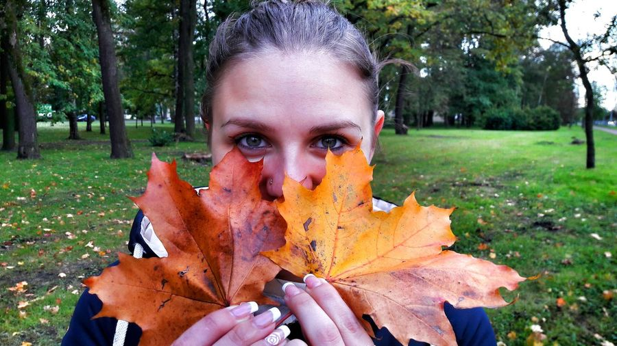 Looking At Camera Autumn Young Adult Tree Leaf Outdoors One Person Lifestyles Leisure Activity Nature Human Body Part Real People Portrait Day Young Women Adult Maple Leaf People Adults Only Human Hand