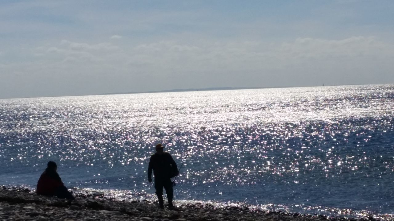 Silhouette Sea Beach Leisure Activity People Sky Men Vacations Outdoors Lifestyles Water Real People Nature Togetherness Scenics Beauty In Nature Adult Adults Only Horizon Over Water Day
