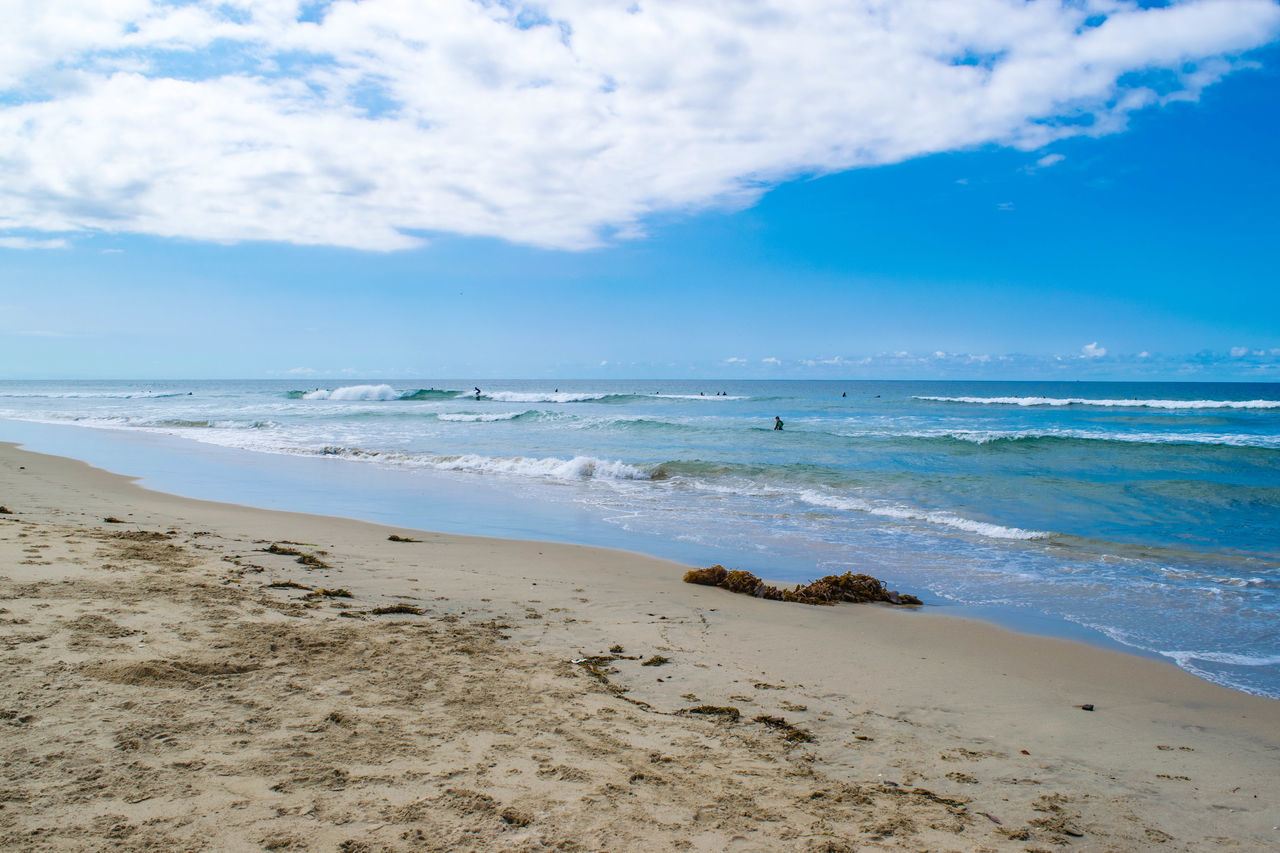 A day at the beach in #southernCalifornia Aqua Beach Beach Photography Blue Sky Blue Wave Calm Sea Calm Water Clouds Clouds And Sky Dog Dog Beach Newport Beach Ocean On The Road On The Shore Relaxing At The Beach Rocks On The Beach Rocks On The Shore Sandy Beach Southern California Tourist Destination