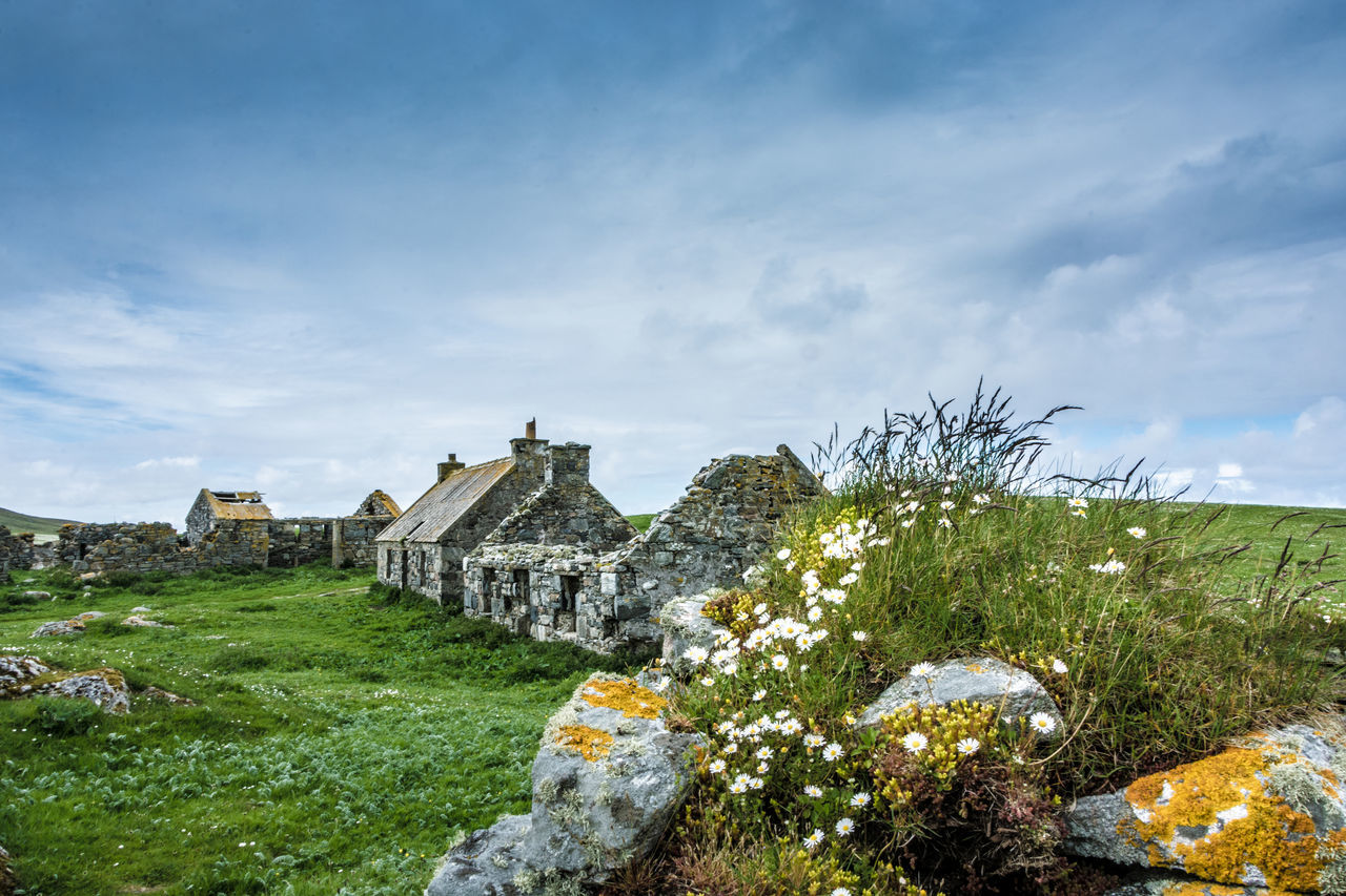 sky, cloud - sky, history, grass, no people, architecture, day, built structure, outdoors, spirituality, place of worship, nature, travel destinations, building exterior, ancient civilization