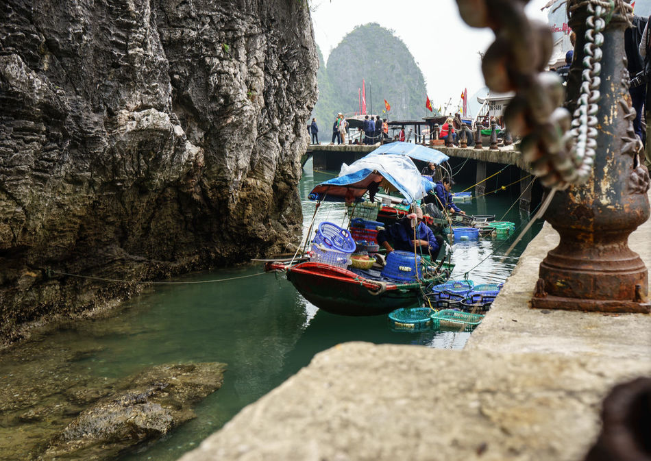 Asia, Vietnam, Travel Ancient Civilization Art And Craft Boa Boat Creativity Cultures Day Depth Of Field Focus On Background Leisure Activity Lifestyles Men Mode Of Transport Nautical Vessel Outdoors Real People Religion River Selective Focus Ship Transportation Travel Vendo Vendor Vietnam Water Women