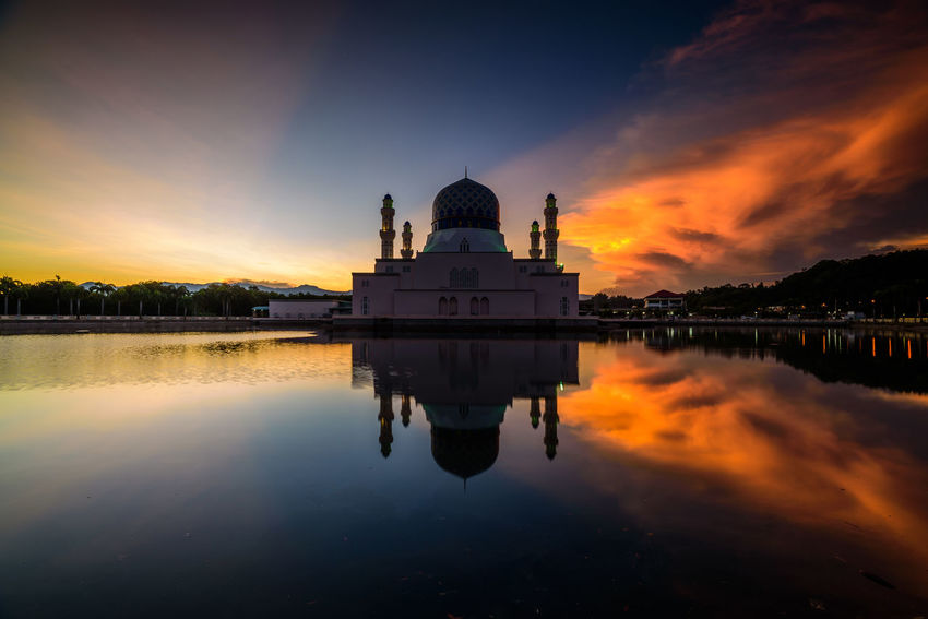 The majestic moment at floating mosque city of Kota Kinabalu during sunrise with clear reflection and magenta color appear. Architecture Kota Kinabalu Architecture Beauty In Nature Building Exterior Built Structure Day Dome Floating Mosque Mosque Nature No People Orange Color Outdoors Place Of Worship Reflection Religion Sky Spirituality Sunrise Sunset Tourism Travel Travel Destinations Water An Eye For Travel