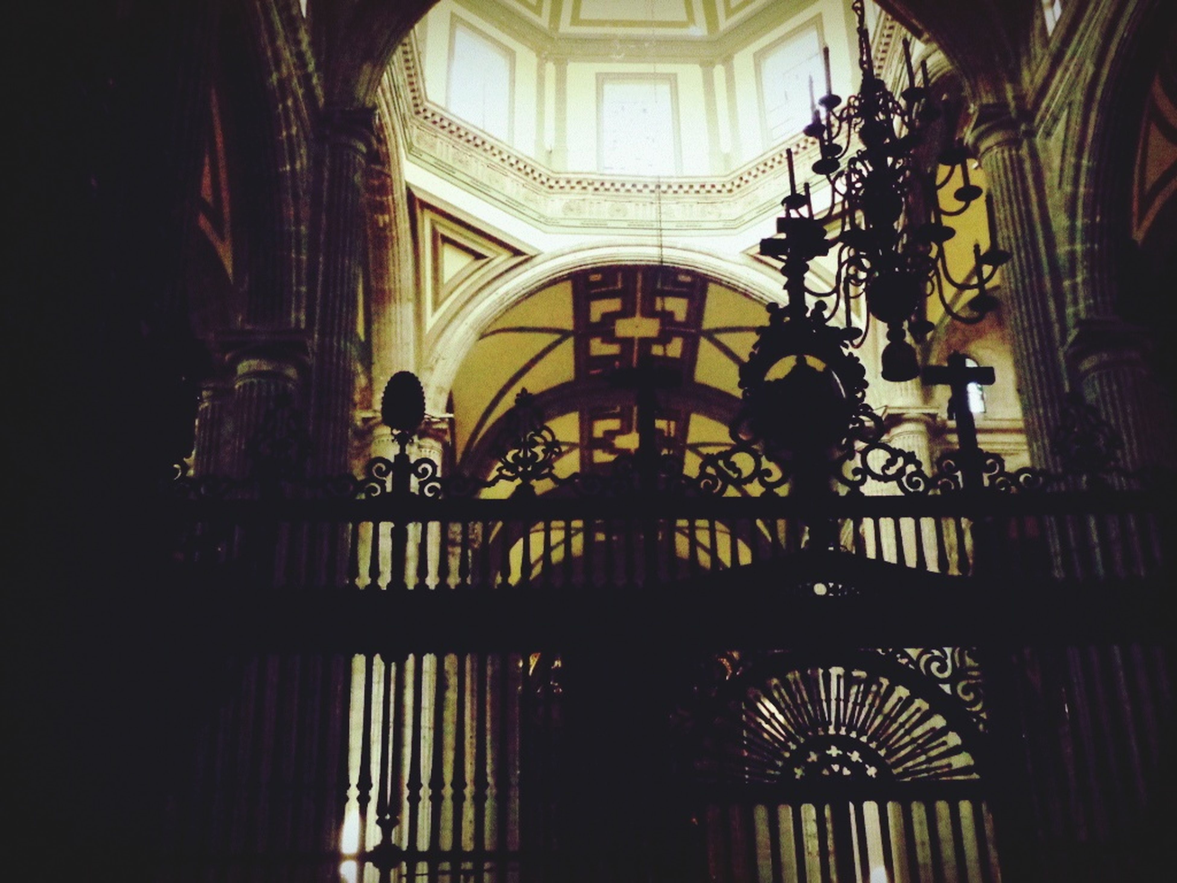 indoors, architecture, built structure, arch, ceiling, railing, window, silhouette, place of worship, men, low angle view, church, travel, religion, incidental people, interior, person, chandelier, day