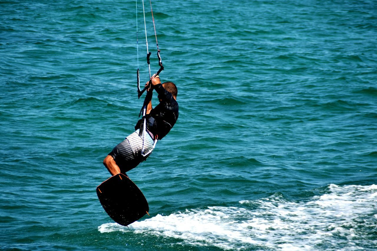 Sea Sport Water Skill  Day Extreme Sports One Person Motion Athlete Men Outdoors Adults Only People Adult Young Adult Sportsman Activity Beach Kitesurfing Kitesurf Kite Aquatic Sport Nature Leisure Activity Skill