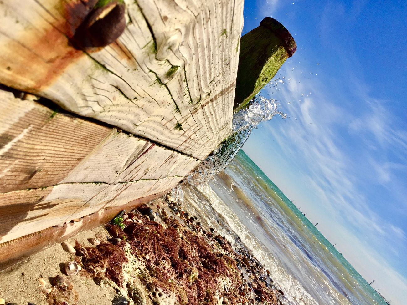 Textured  Close-up Splashing Water Splashing Waves ShotOniPhone6 Warm Wavebreak Wood - Material Power In Nature Beauty In Nature Outdoors Motion Day No People Wave Sea Water Low Angle View Colourful Sky Sunlight Blue Splash Beach