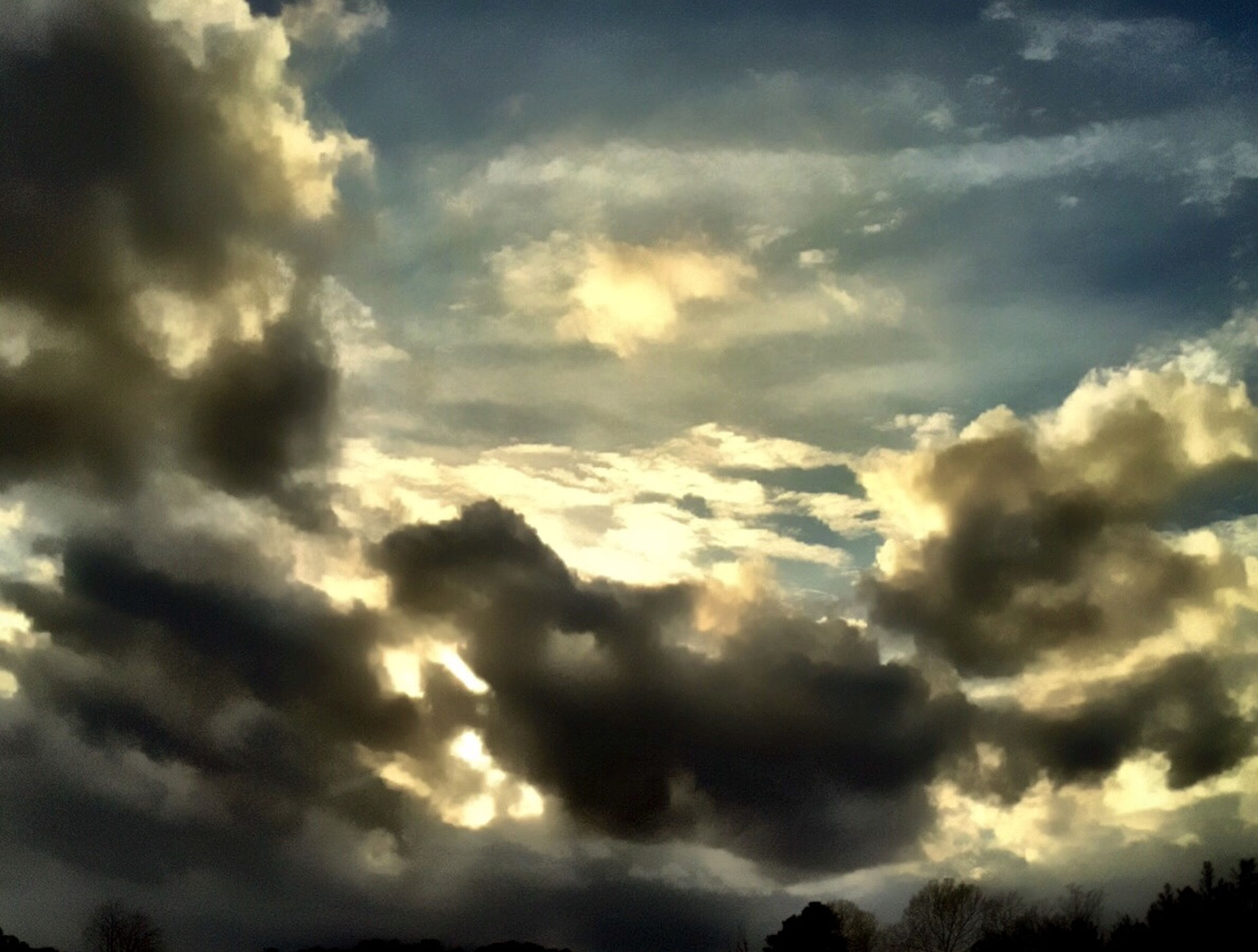 sky, cloud - sky, beauty in nature, scenics, tranquility, cloudy, cloudscape, tranquil scene, low angle view, nature, sky only, cloud, weather, idyllic, silhouette, sunset, overcast, dramatic sky, majestic, outdoors
