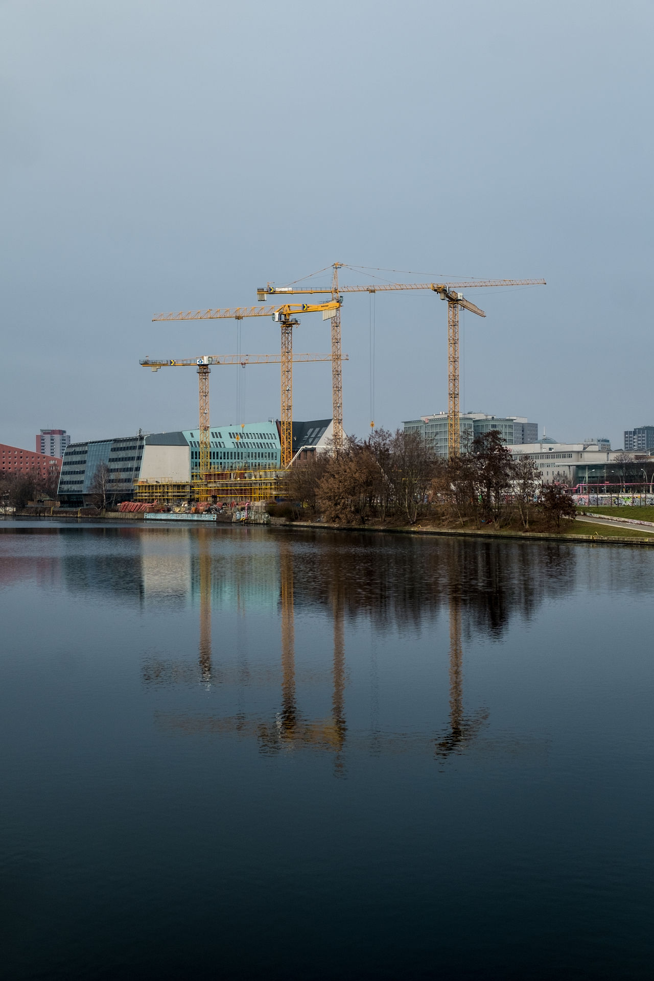 Berlin Built Structure Construction Construction Machinery Crane Crane - Construction Machinery Day Industrial Equipment Industry No People Outdoors Reflection Sky Spree Spree River Water