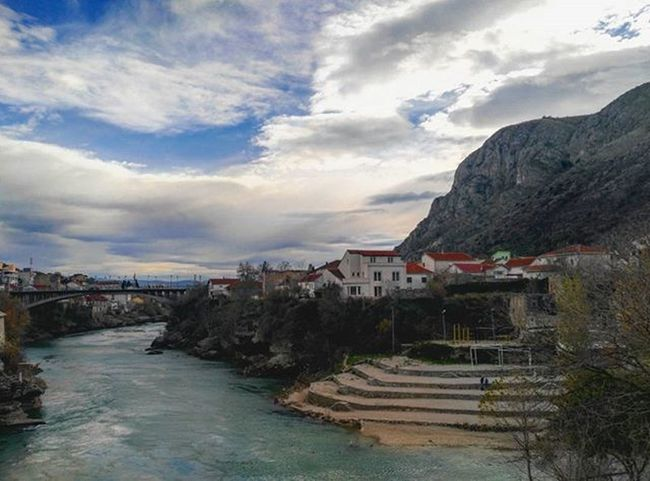📷☁🌉👌 View from the old bridge in Mostar. Tb Sky Skylovers Clouds Scenery Landscape Colors Green River Riverside Old Bridge Neretva Mostar Travel Traveling Instatravel Vscocam Naturelovers HDR Huaweisnapys Huaweig7 Shareyourlandscape Likeforlike Follow4follow like4like loveletterto