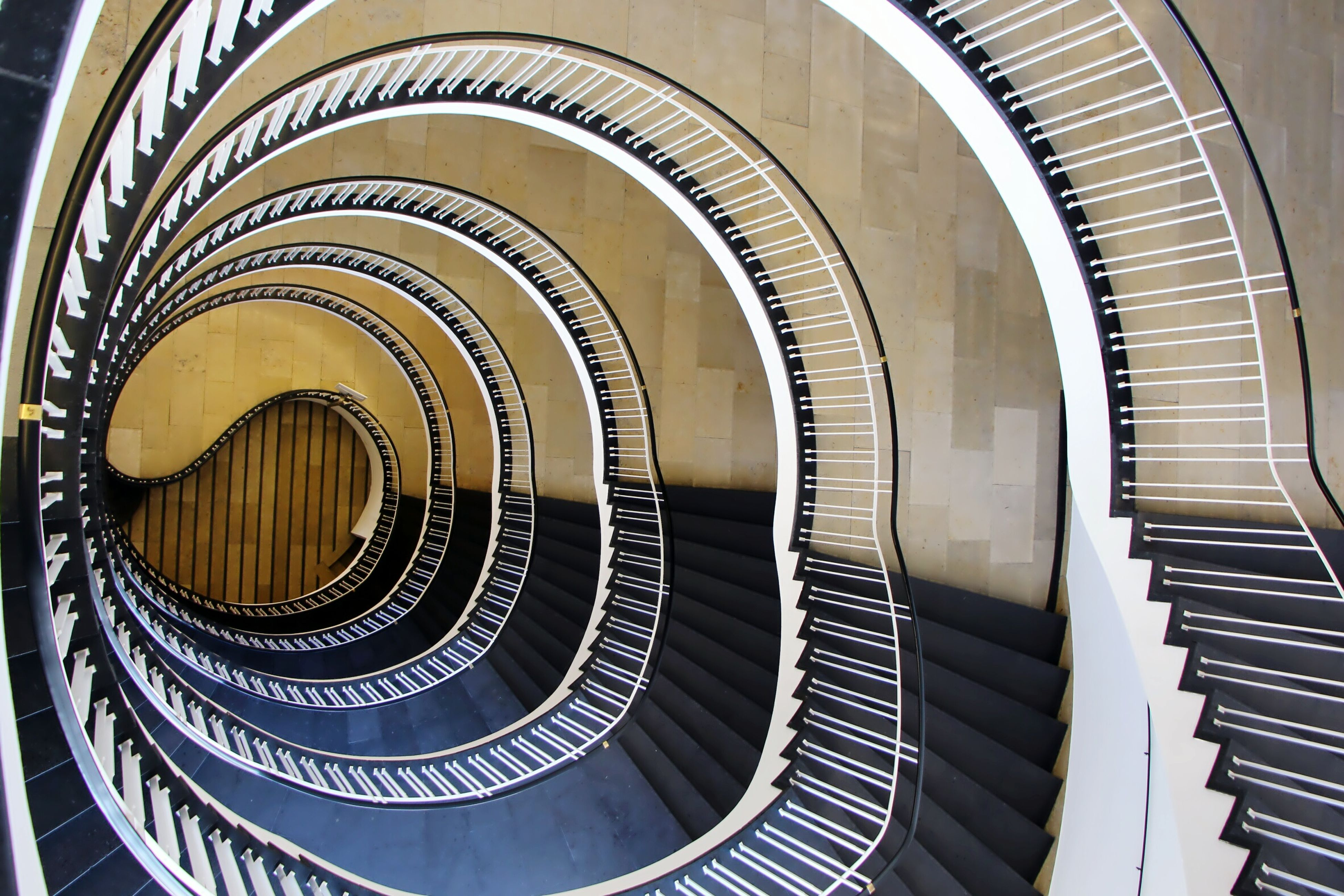 steps, steps and staircases, spiral, railing, spiral staircase, staircase, repetition, built structure, high angle view, indoors, architecture, low angle view, design, building story, curve, diminishing perspective, concentric, architectural feature, no people, modern, geometric shape