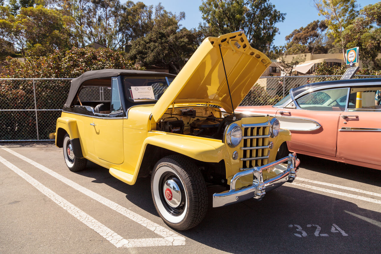 Laguna Beach, CA, USA - October 2, 2016: Yellow 1951 Willys Jeepster owned by Edward Brocknau and displayed at the Rotary Club of Laguna Beach 2016 Classic Car Show. Editorial use. 1951 Car Show Classic Car Classic Car Show Day Jeep Jeepster Laguna Beach, CA No People Old Car Outdoors Vintage Car Willys Jeepster