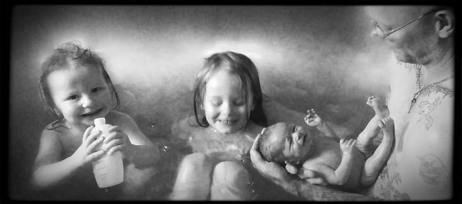 """The Portraitist - 2016 EyeEm Awards My new fave """"In the monebt picture"""" of my wonderful husband and all but one of our boys in our tub. All their faces say it all. Very blessed and a photographers dream to have been able to be their apart of it and as a extra, capture it. What a great bathroom pic this will be for us!! EyeEm EyeEm Best Edits Black And White Baby Capture The Moment EyeEm Best Shots - People + Portrait Freelance Life Son Sons And Dad"""