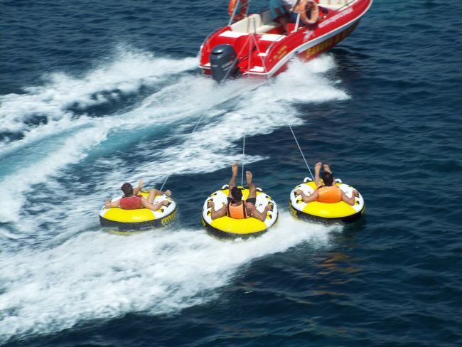 Mediterranean Sea Sea Watersports Water Sports Rubber Rings Boat Blue Water Water Spray People Travel Destinations Travel Photography Tourist Attraction  Tourism Tourists Rope On The Way
