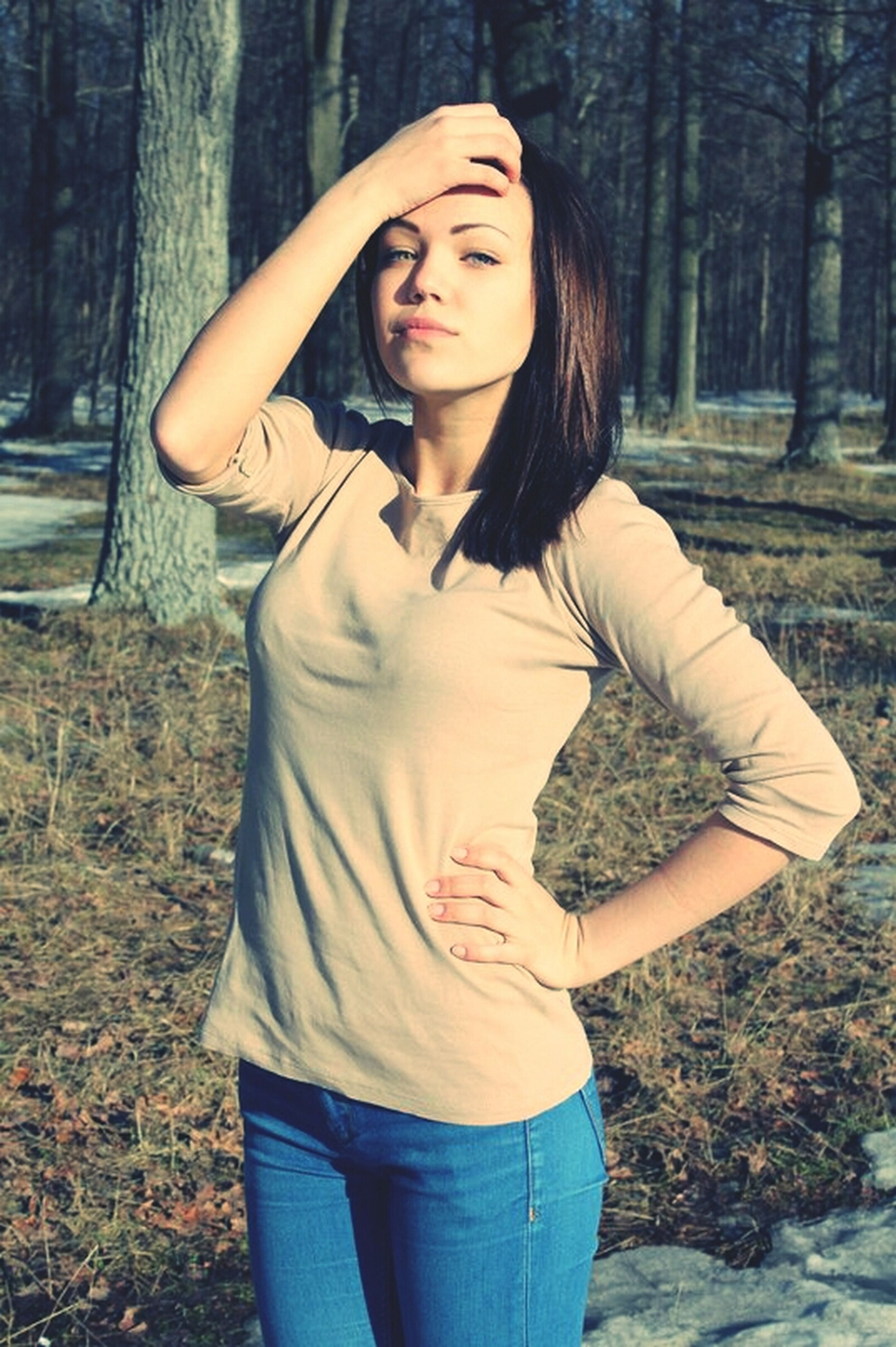 young adult, tree, young women, forest, lifestyles, standing, front view, casual clothing, person, three quarter length, long hair, portrait, waist up, looking at camera, tree trunk, leisure activity, beauty