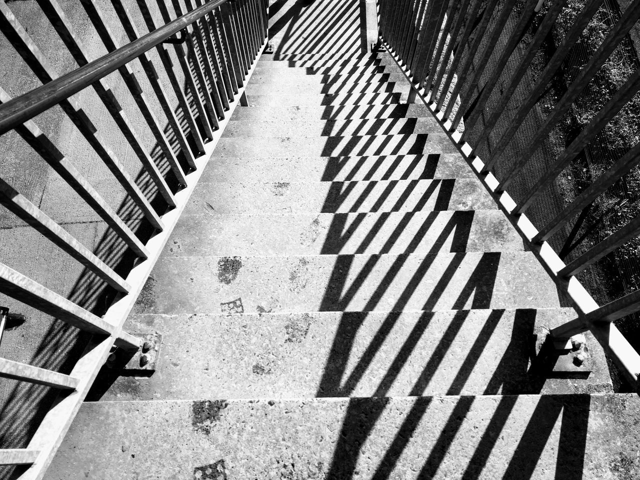 High Angle View Of Shadow On Stairs