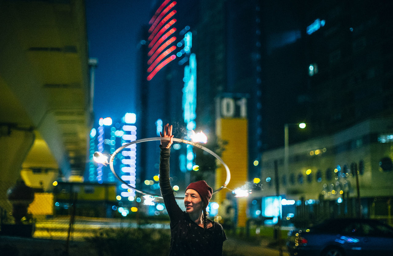City City Life Fire Hula Hooping  Illuminated Neon Night Nightlife Only Women Outdoors Party - Social Event Performance Real People Skyscraper Women Around The World