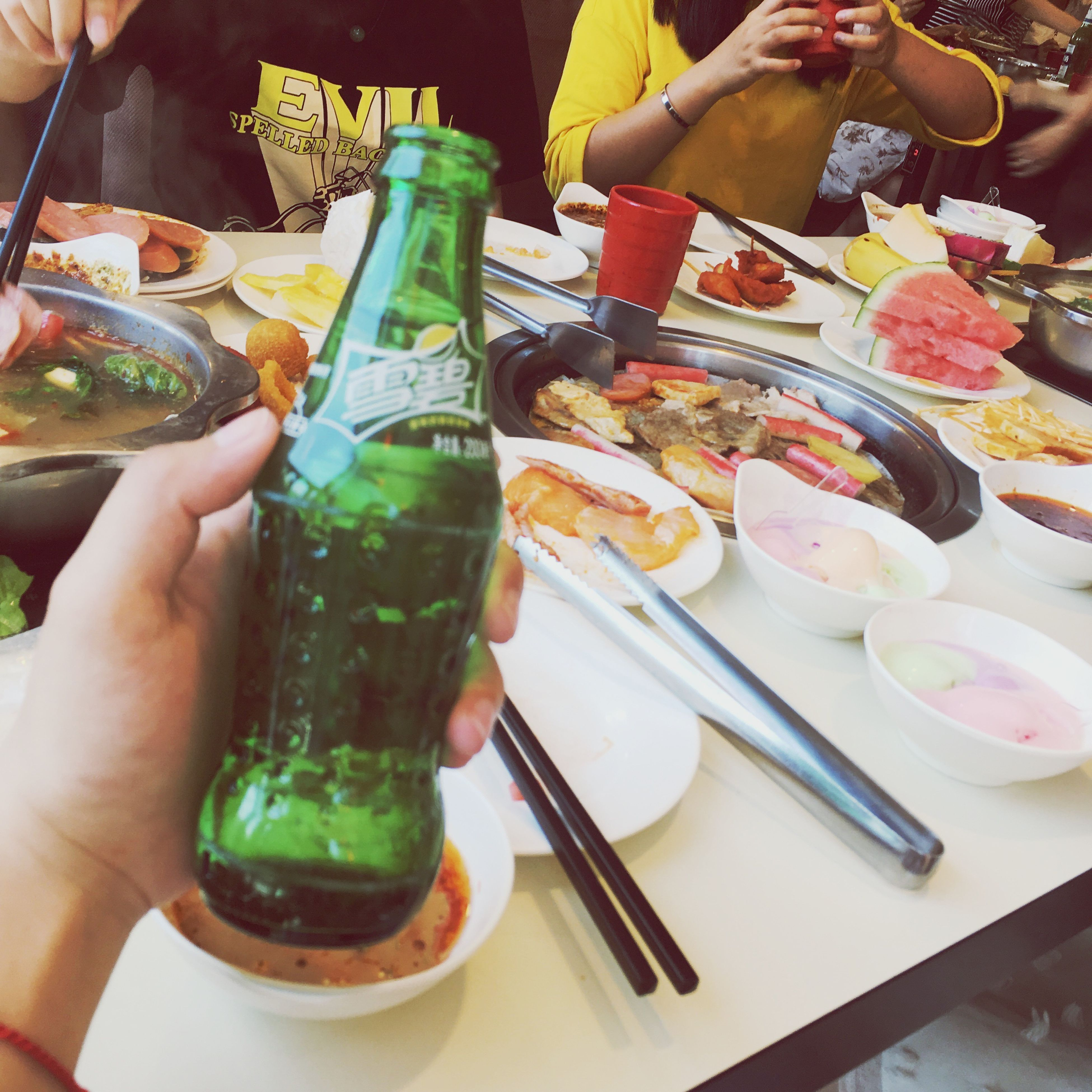 human hand, food and drink, real people, human body part, food, drink, holding, table, bottle, refreshment, drinking straw, fork, plate, men, freshness, chopsticks, indoors, one person, ready-to-eat, drinking glass, lifestyles, healthy eating, day, women, close-up, alcohol, eating, friendship, people