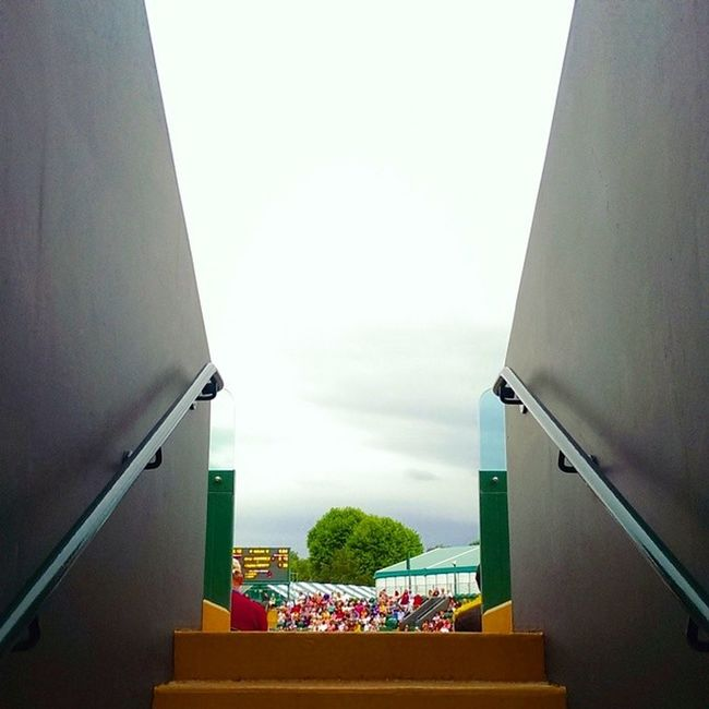 Stepping onto court. Wimbledon London Lom_nlue Tennis