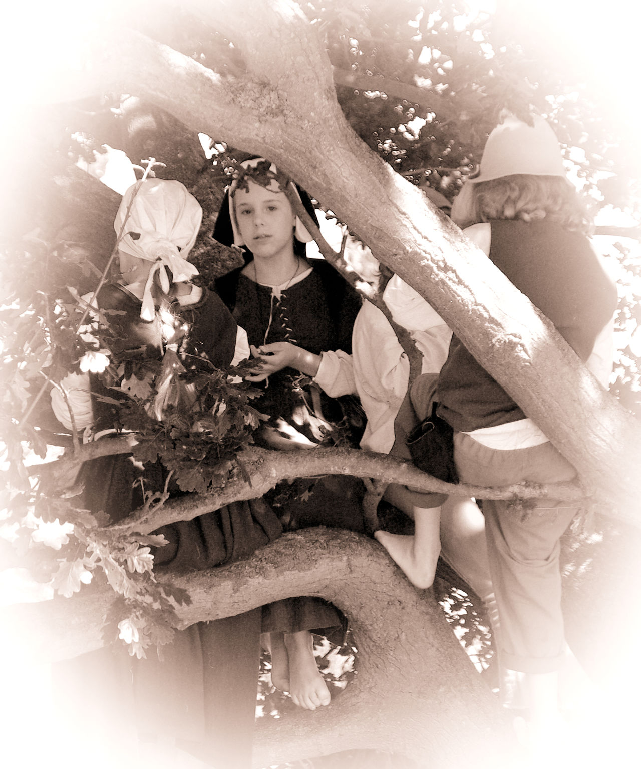 Up a tree Childhood Historic Dress Historical Reinactment Lifestyles Medieval MedievalTimes Sepia Sitting Vignette Young Adult