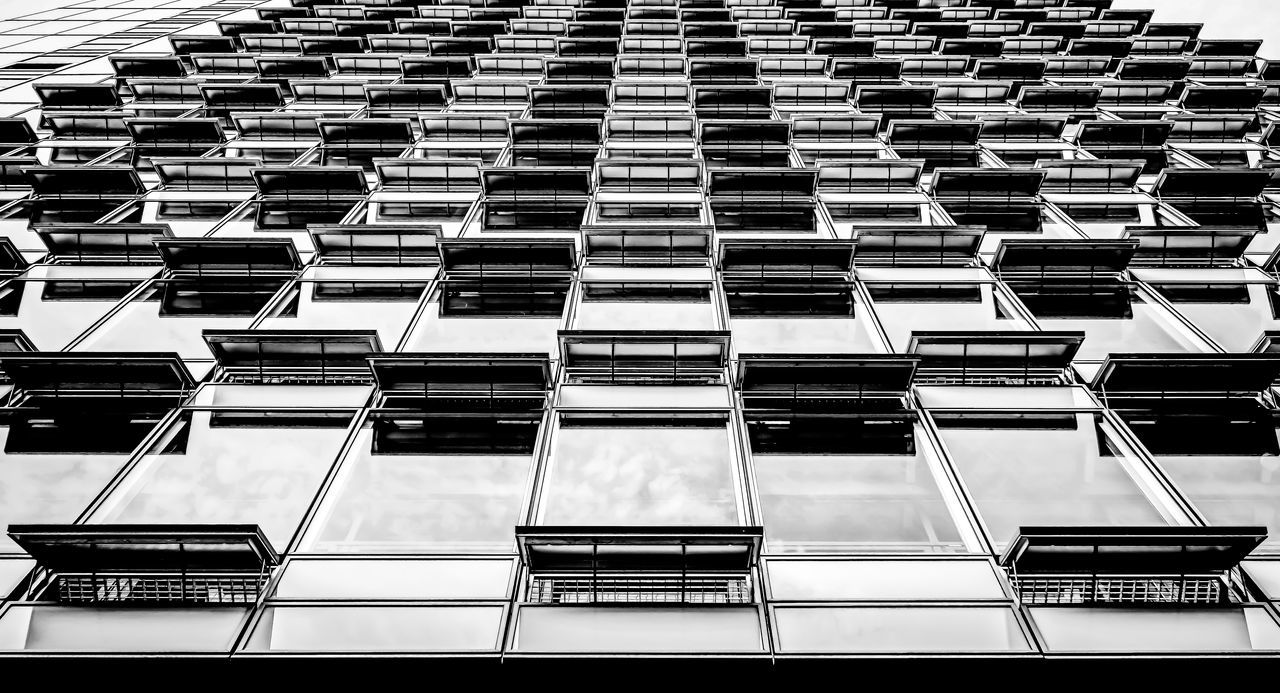 Black & White Low Angle View Modern Architecture Architectural Style Architecture Black And White Building Exterior Built Structure City Day Full Frame Modern No People Open Outdoors Sky Window