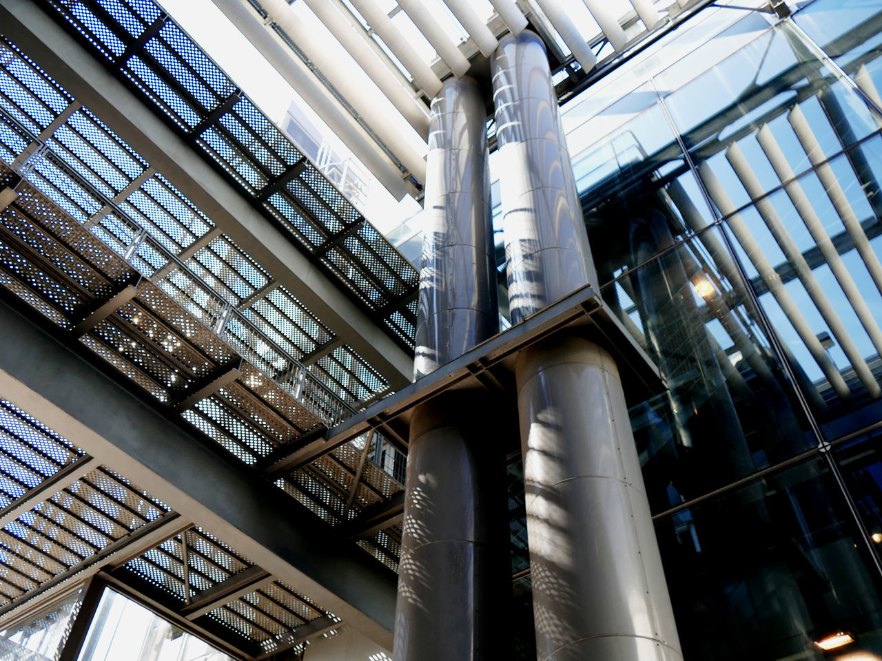 low angle view, indoors, modern, built structure, architecture, day, no people, architectural column, library