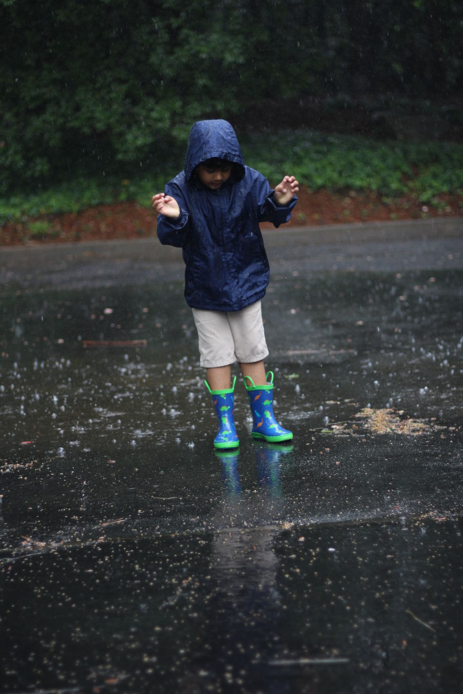 Childhood Day Full Length Nature One Person Outdoors People Puddle Rain Real People Road Tree Walking Warm Clothing Water Wet