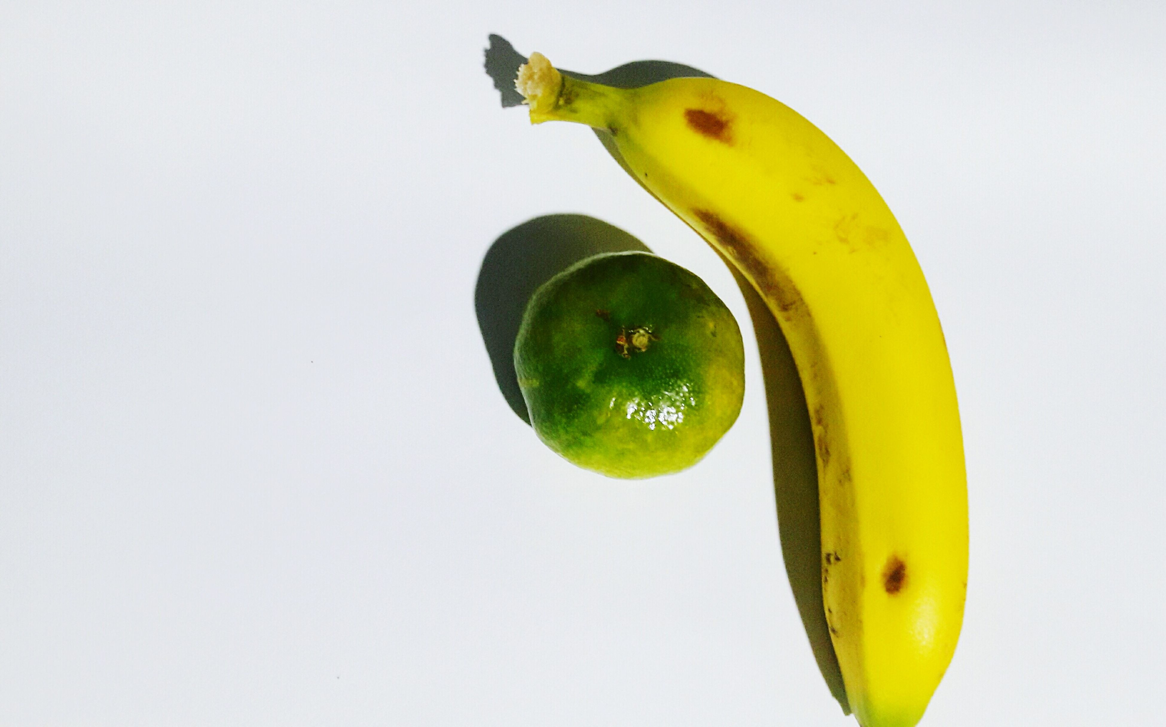 fruit, yellow, banana, green color, food and drink, studio shot, food, white background, no people, healthy eating, low angle view, freshness, close-up, nature, day, outdoors