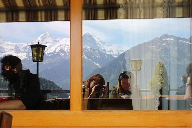 Dramatic Angles Mountain Mountain Range Rear View Window Person Snowcapped Mountain Restaurant Scenics Tranquil Scene Beauty In Nature Nature Day Looking Culture Tranquility Tourism in Jungfrau Switzerland
