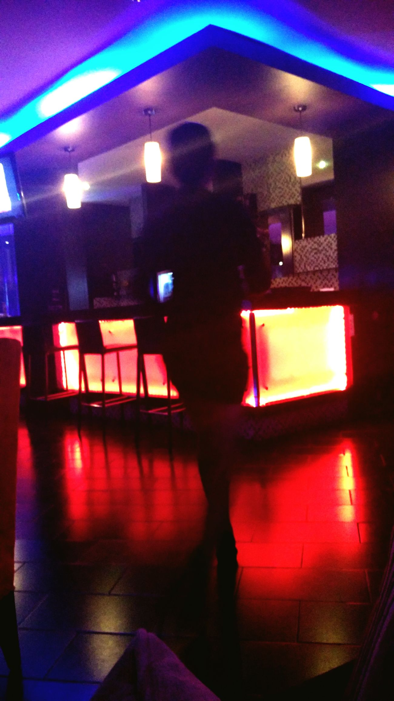 A hostess at a spa. Dramatic Lights Bar Red And Blue LED