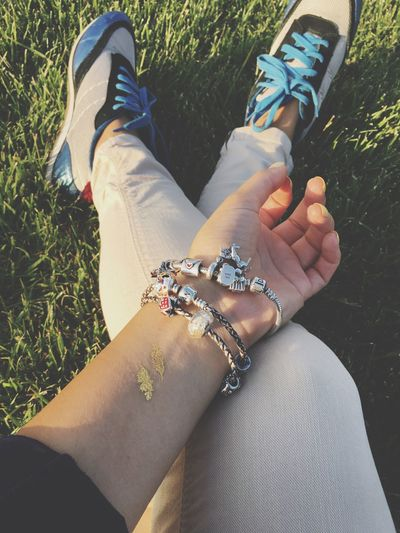 Sochi Chilling Sitting Legs Training Hand Flesh Tattoos Bracelet Temporary Tattoo Sitting On Grass Sitting Outside Fashion Unrecognizable Person Relaxing