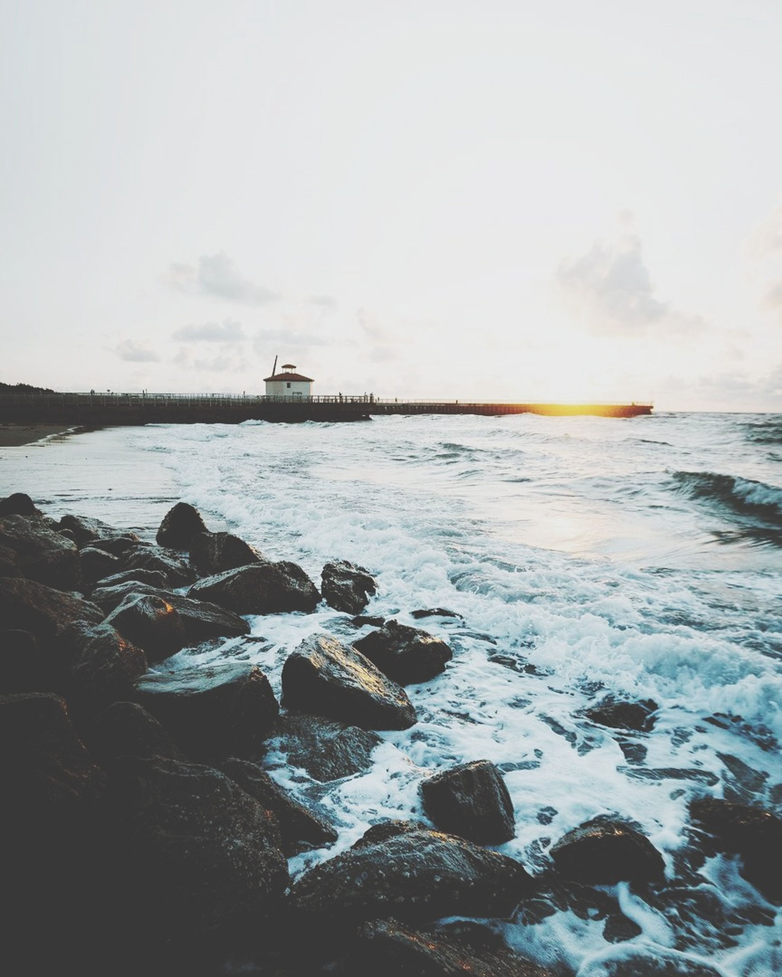 sea, water, rock - object, nature, outdoors, beauty in nature, no people, sky, scenics, day, nautical vessel, wave, horizon over water