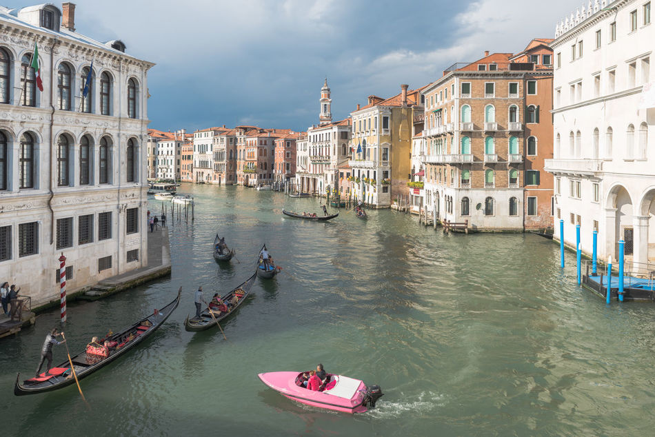 Heavy traffic on Canal Grande Architecture Boats Buildings City City Life Cityscape Clouds And Sky Cruisin' Gondola Pink Sea Sky Transportation Venice Water Art Is Everywhere