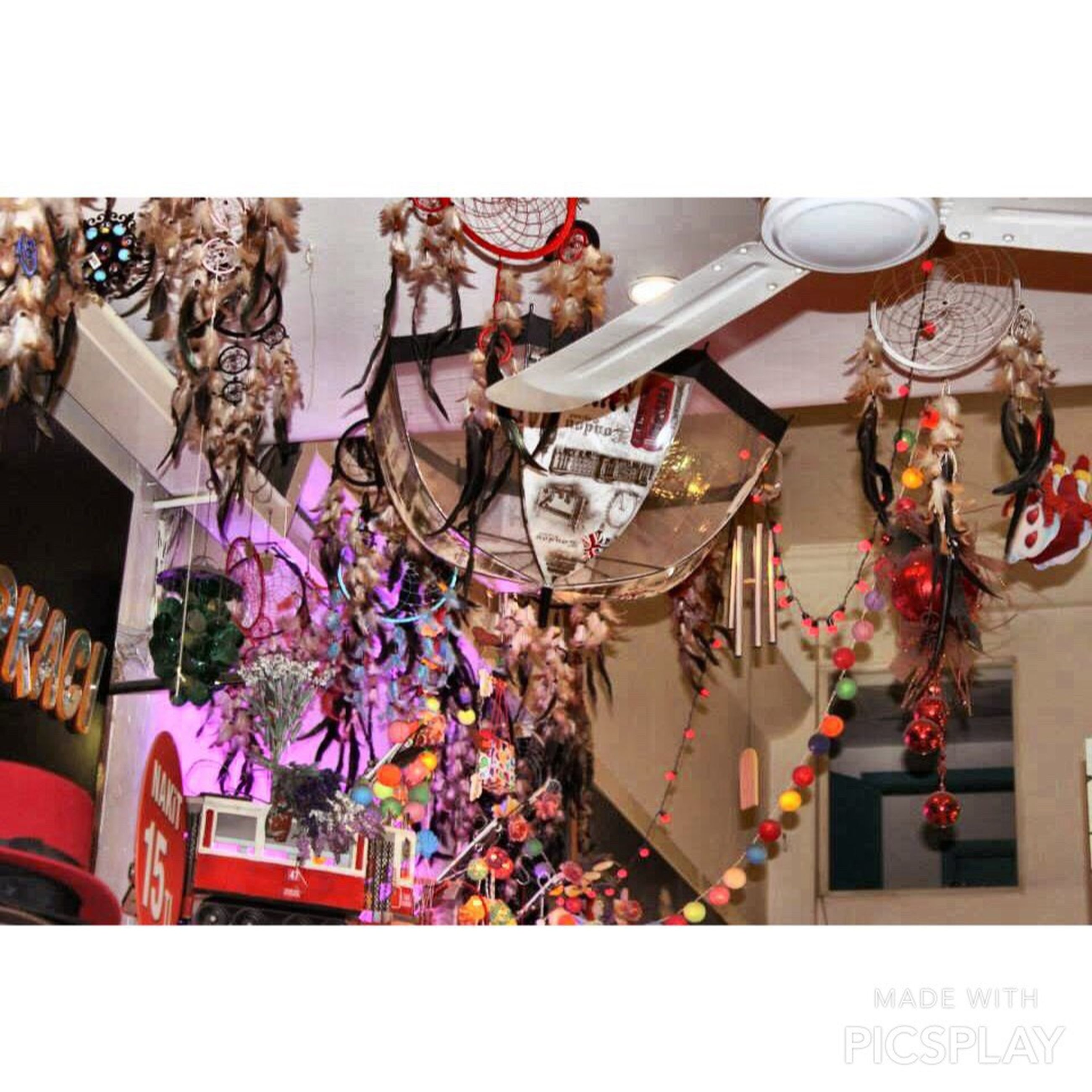 decoration, hanging, variation, indoors, multi colored, art and craft, flower, celebration, choice, built structure, tradition, large group of objects, abundance, architecture, retail, cultures, art, creativity, low angle view, arrangement
