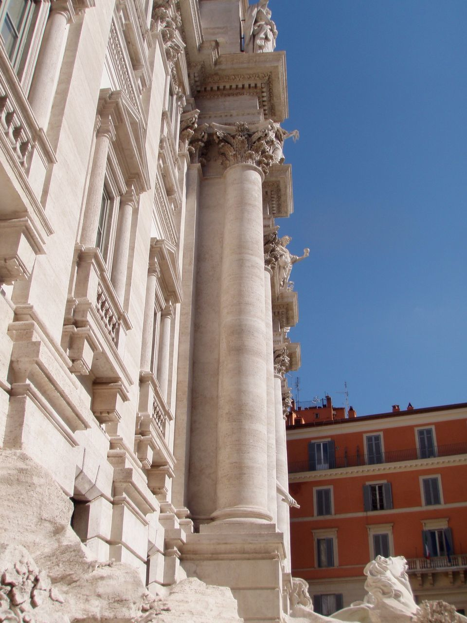 architecture, built structure, architectural column, building exterior, history, low angle view, outdoors, no people, day, city, sky