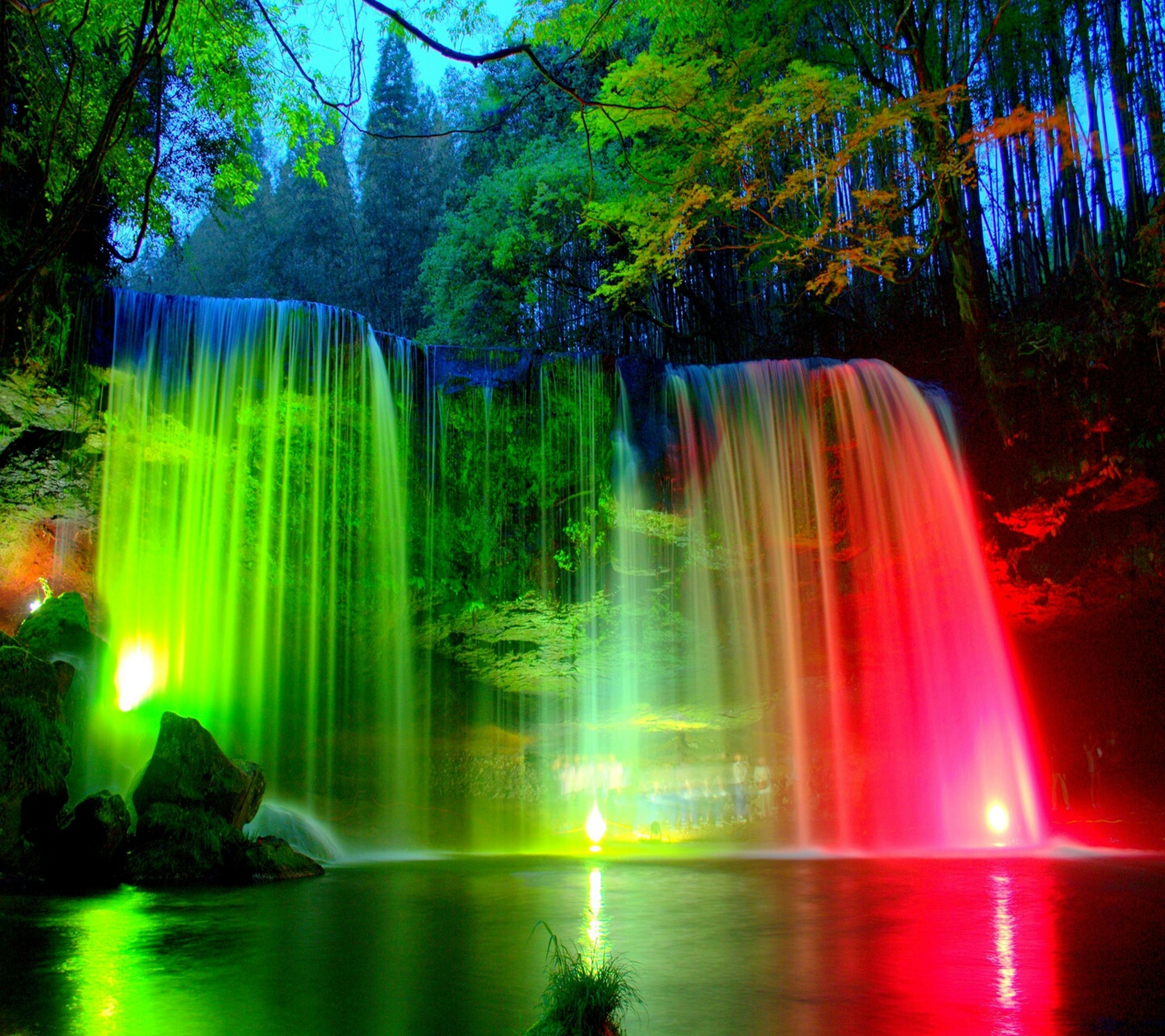 water, tree, reflection, fountain, long exposure, beauty in nature, waterfront, motion, multi colored, scenics, nature, tranquility, tranquil scene, idyllic, pond, flowing water, waterfall, outdoors, green color, park - man made space