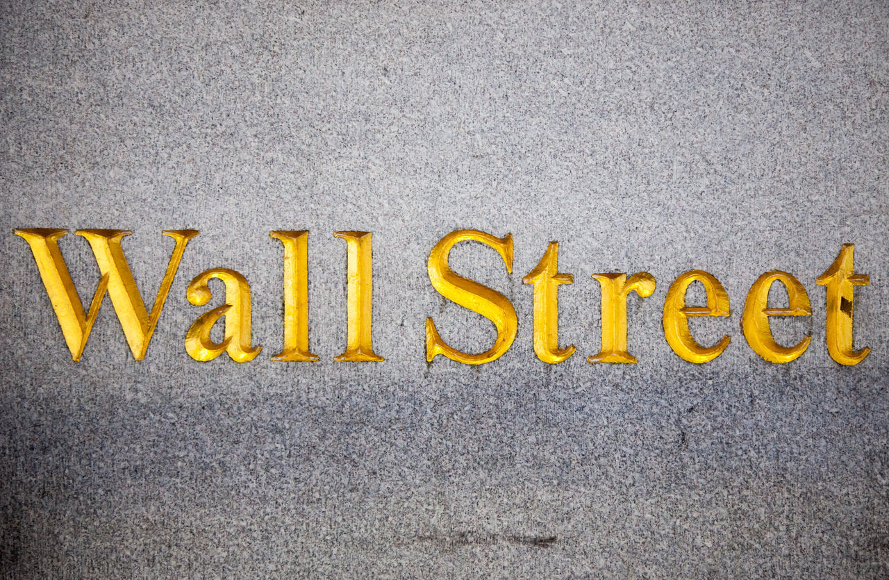 Engraved Wall Street Sign On Wall Of New York Stock Exchange