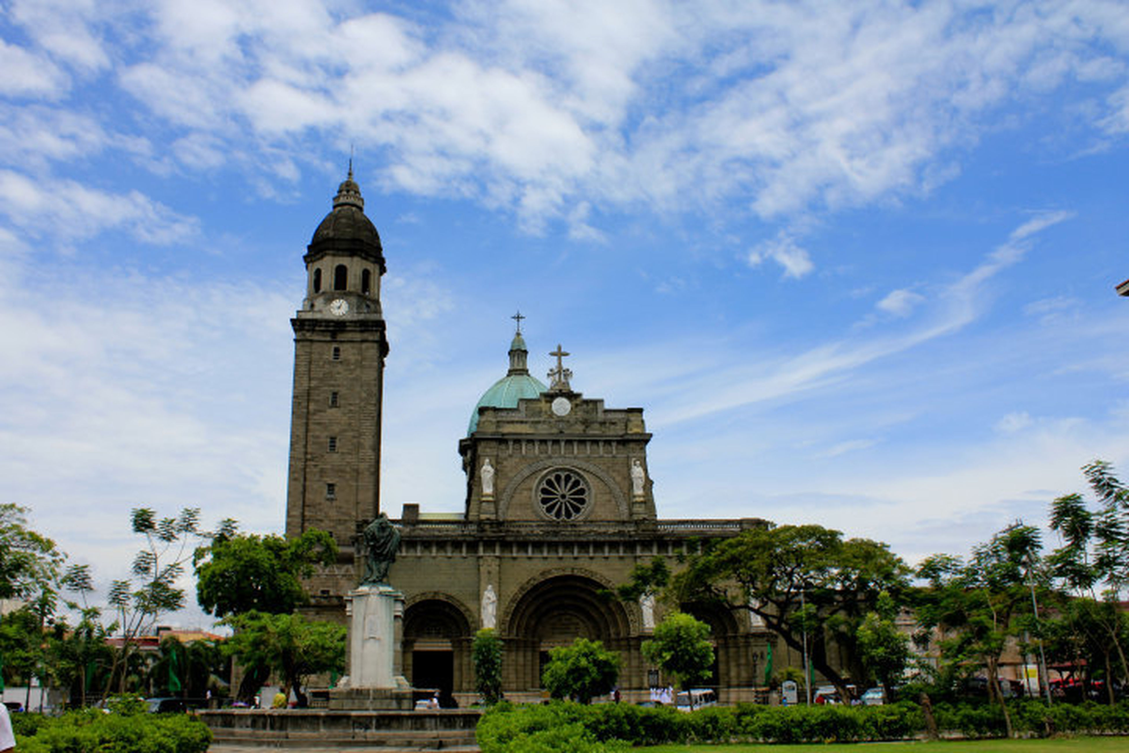 architecture, built structure, building exterior, religion, sky, tree, place of worship, church, spirituality, cloud - sky, history, low angle view, arch, facade, cloud, cathedral, famous place, travel destinations