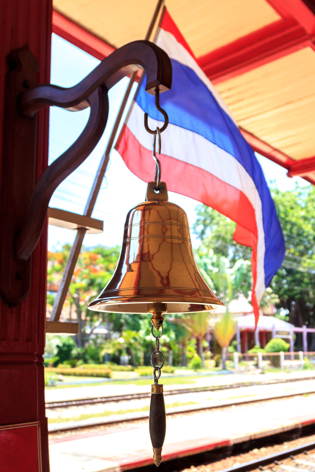 Hua Hin train station's bell and Thai flag Arrival Bell Built Structure City City Life Close-up Commuter Country Countryside Day Focus On Foreground Hanging Journey Railway Station Railway Station Platform Ring Station Thai Culture Thai Flag Thailand Train Station Travel