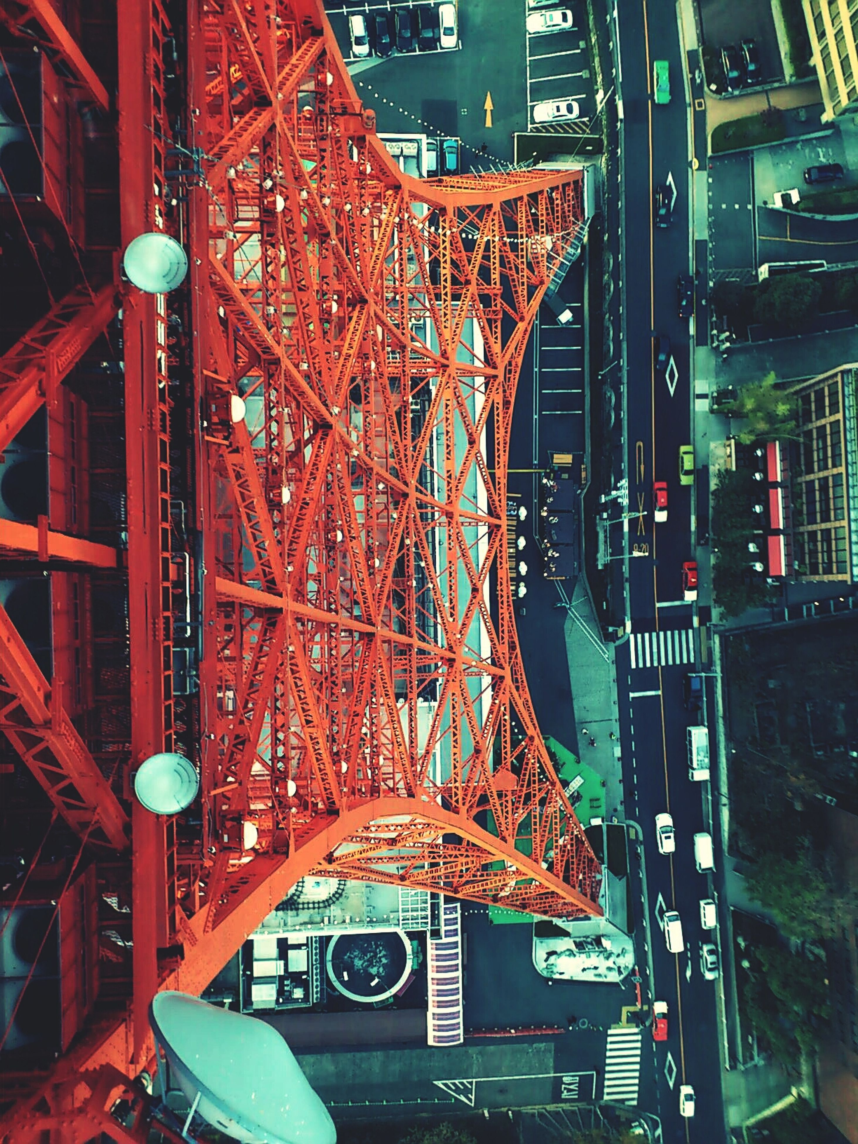 architecture, built structure, illuminated, building exterior, city, transportation, bridge - man made structure, famous place, travel destinations, engineering, connection, night, capital cities, travel, metal, international landmark, high angle view, tourism, red, outdoors