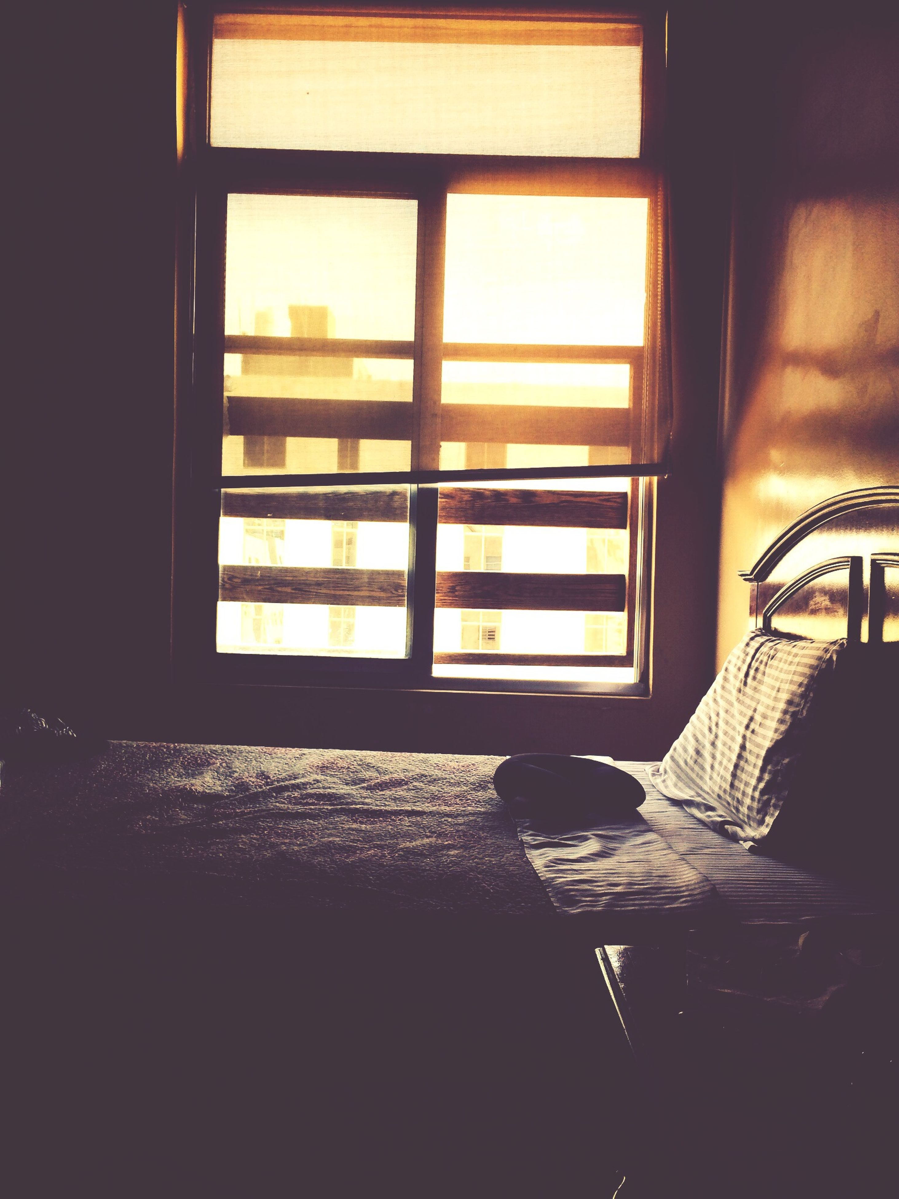 indoors, window, home interior, glass - material, architecture, sunlight, built structure, chair, table, house, transparent, absence, no people, shadow, day, empty, window sill, dark, open, wall - building feature
