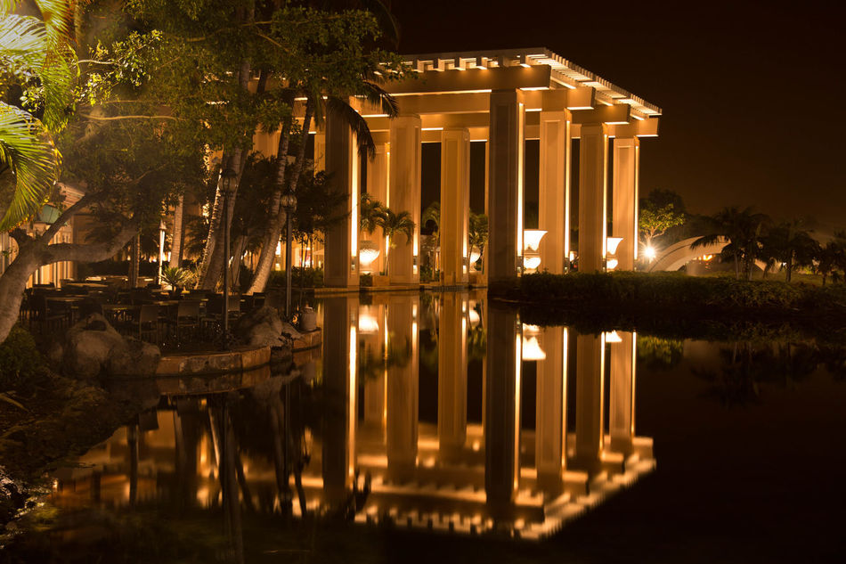 Reflection at midnight!😊🌉 Reflection Architecture Pillars Pillars In The Water Nature Trees Night Built Structure Building Exterior Water Sky Sea Palm Trees light and reflection Seaside Long Exposure in United States