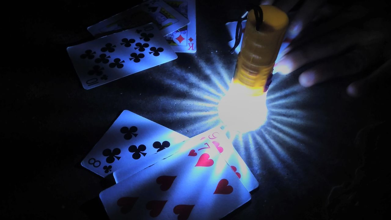 Close-up Gambling Human Hand Indoors  Leisure Games Lights People Torchlight
