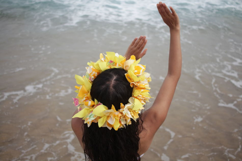a tahitian dancer facing the ocean in huatulco mexico. Beauty In Nature Close-up Day Flower Flower Head Focus On Foreground Fragility Freshness Indepencia Leisure Activity Lifestyles Nature Outdoors Part Of Petal Rippled Tranquility Unrecognizable Person Water Yellow