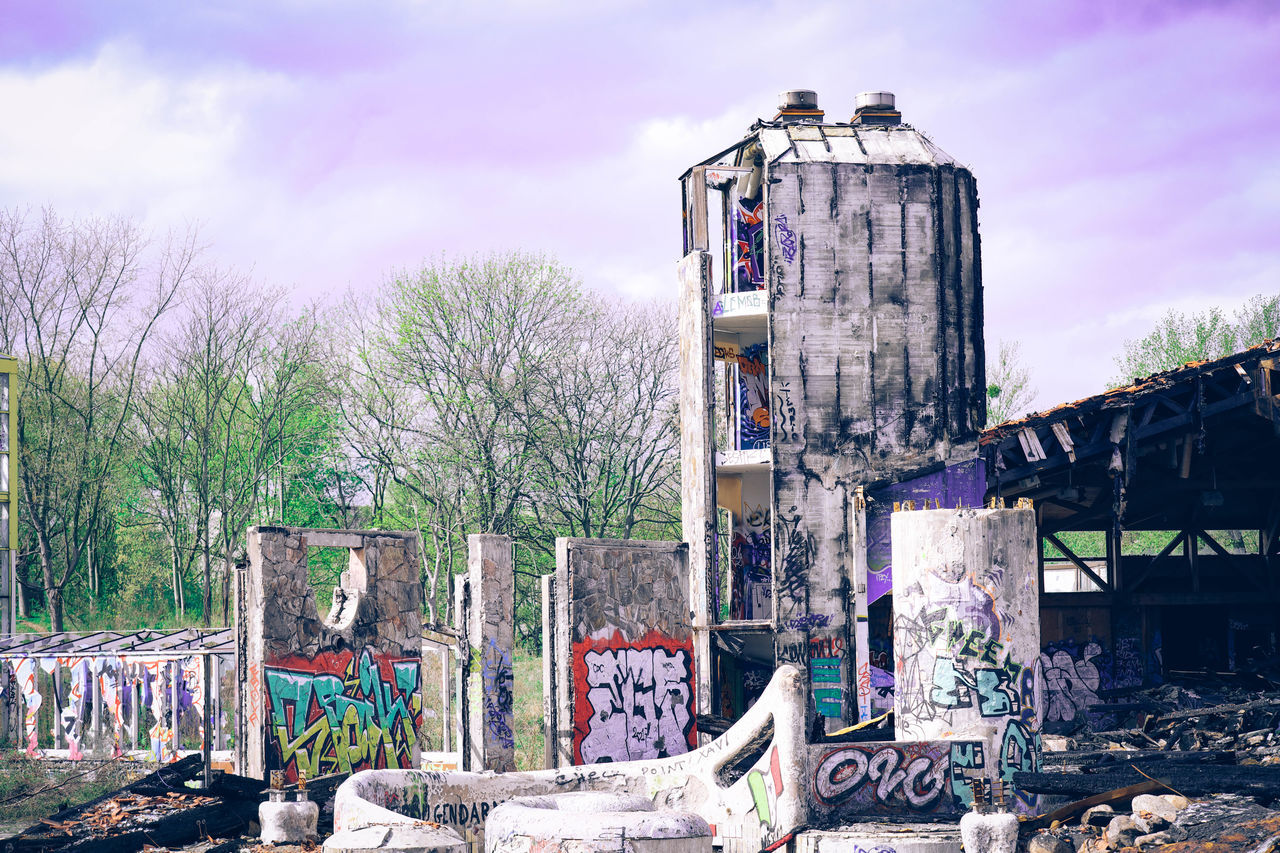 graffiti, tree, built structure, sky, outdoors, day, no people, architecture, nature