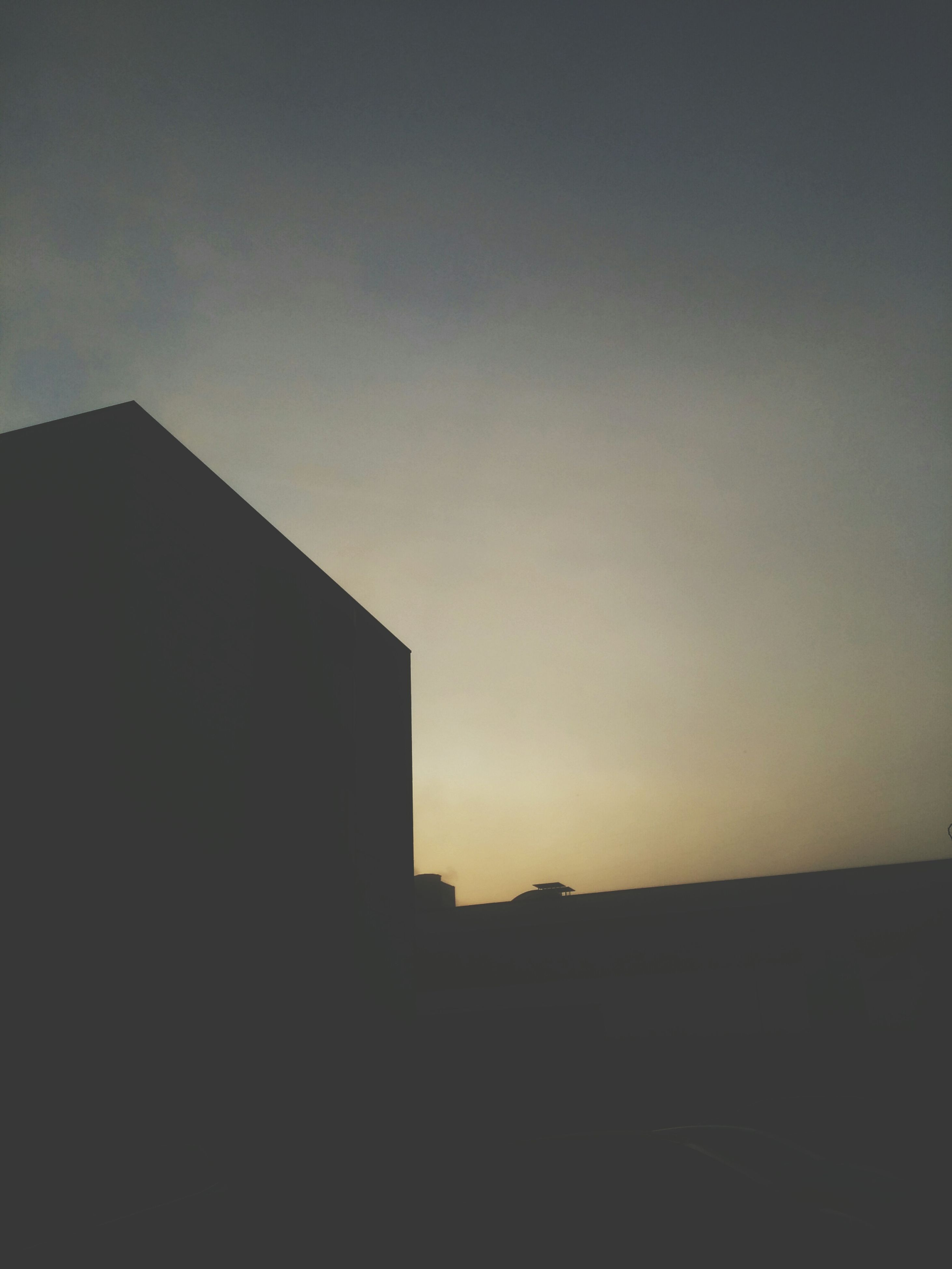 architecture, built structure, copy space, building exterior, silhouette, sunset, clear sky, sky, low angle view, building, residential structure, house, outdoors, no people, dark, residential building, city, dusk, nature, orange color