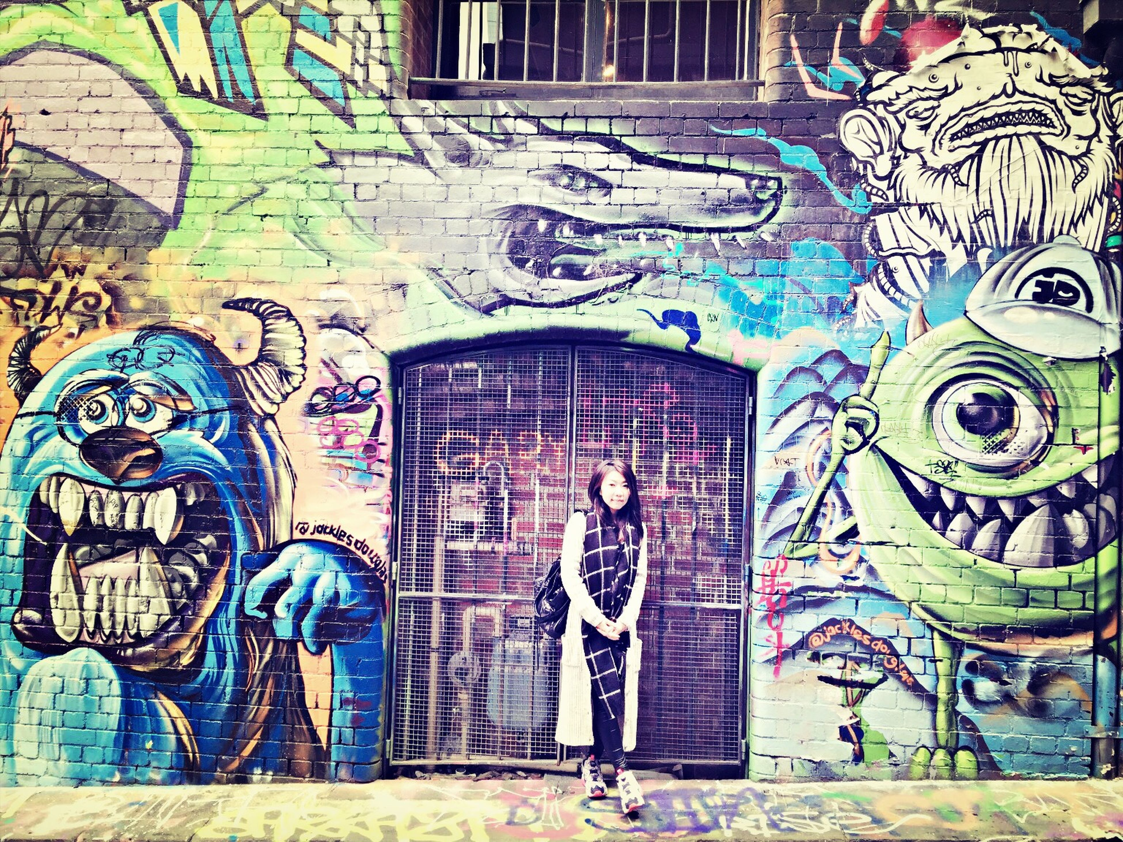 graffiti, art and craft, art, architecture, creativity, built structure, building exterior, wall - building feature, multi colored, mural, street art, pattern, wall, human representation, design, building, painting, outdoors, day, window